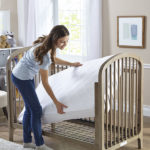 Mom adjusting the crib mattress