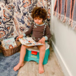 Kid sitting and reading on Elmo Hooray! Sesame Street Potty