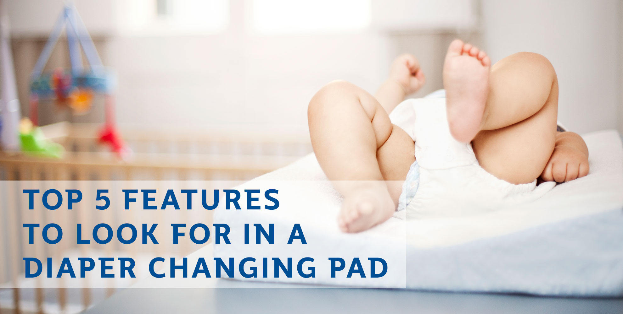Image of baby laying down on changing pad.