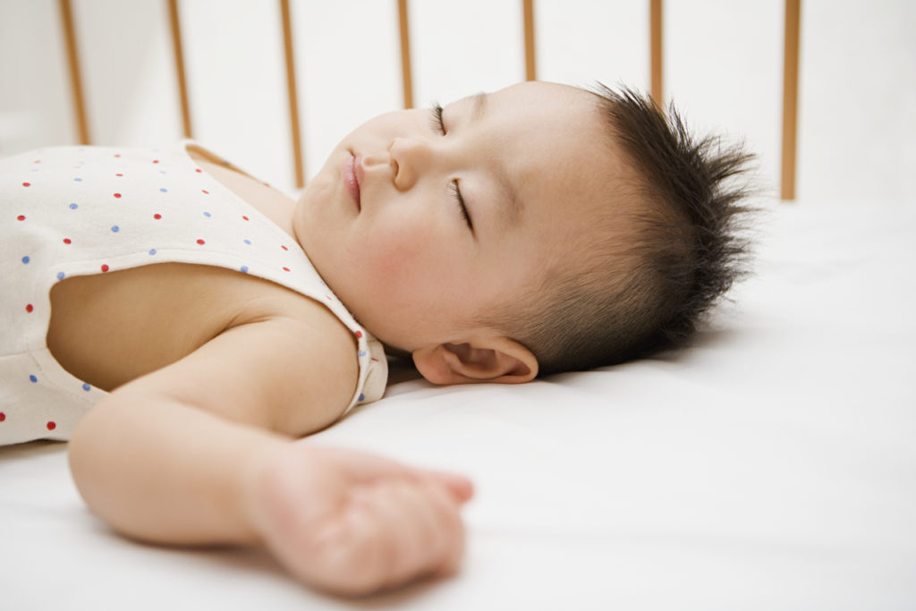 baby sleeping on best crib mattress